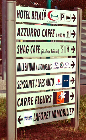 <Photo of a French signpost with Shag Cafe>