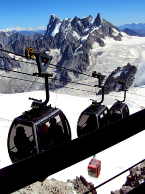 <Picture of the telecabine to the Helbronner peak in Italy from the Aguille du Midi in Chamonix, France.>