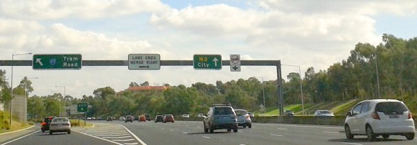 Melbourne's Eastern Freeway - merge left sign