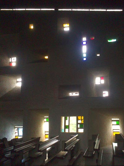 <Photo of interior windows at Notre Dame du Haut, in France'>