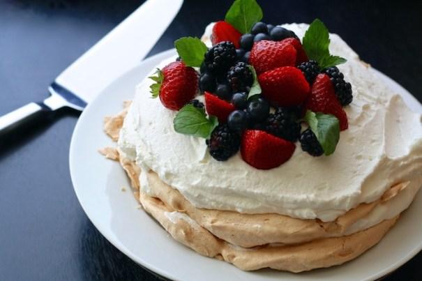 Proper pavlova - fruit, cream, brown crust, gooey centre