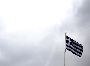 Greek-national-flag-flying-above-parliament-building-Syntagma-Square-Athens