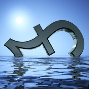 A pound symbol sinking in the waves