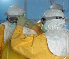 Preparing to enter Ebola treatment unit. Photographer: Athalia Christie  CC BY 2.0  https://www.flickr.com/photos/cdcglobal/15130688115/in/photolist-p43Jr2-oLxNxr-p43J5k-pgsjNp-pgsjZr-pgsi4J-pgsjPX-pgsjST-pgsk2k-ptmyE4-ptmyEV-ptBqy5-ptmyB8-ptmyBP-ptmyCk-pd9Vkc-oAPeN8-ojAoaZ-oB5MhV-ojAEuF-ojAM4x-oz4czE-oAT35U-oB5KhT-ojAKUt-oB45Qb-ojAkJM-ojA9gg-oCQGAz-ojA3Bb--oAP5UB-ojAPrD-ojAuPk-oAP9Qx-ojAUj4-oCQUKp-ojAJDT-oz46RA-oASFEq-oASVgJ-oz4hdN-oB5L6r-oB5ZCg-ojAwi1-oCQU5B-orEj8m-oygmKP-oygn5M-oygnaM