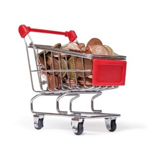a shopping cart is filled with coins