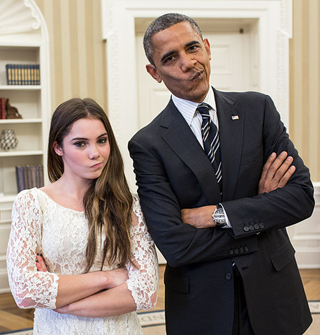 "President Barack Obama jokingly mimics U.S. Olympic gymnast McKayla Maroney's ""not impressed"" look while greeting members of the 2012 U.S. Olympic gymnastics team in the Oval Office"
