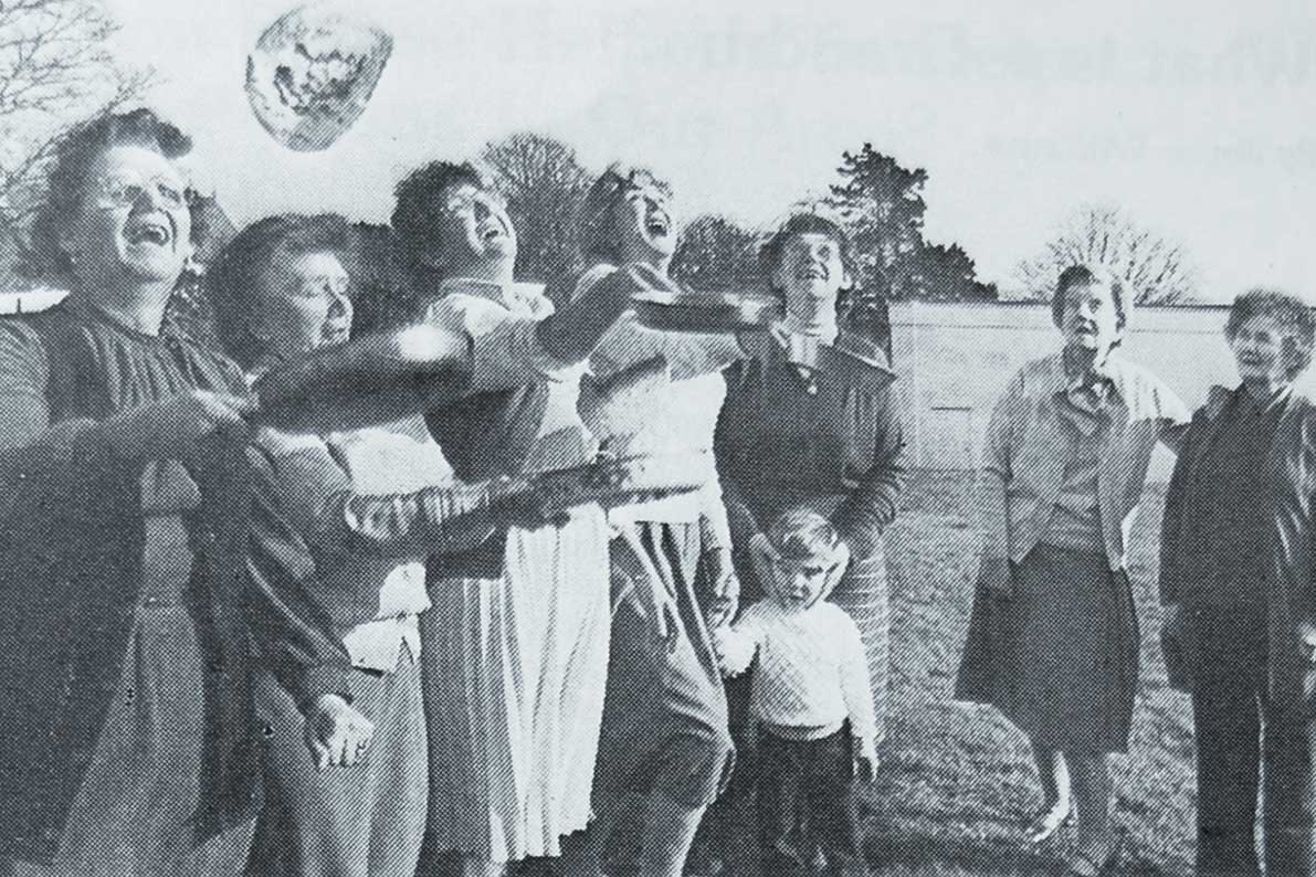 Seen here at the annual Pancake Day coffee morning held by the Ladies' Guild at Longfields are the Guild's Catering Officers, Mrs. Amy Harris, Mrs. Margaret Grey, Mrs. Elsie Rowlands and Mrs Joyce Williams, all tossing pancakes, watched by Mrs. Joan Owen, Mrs Owen Davies and Mrs. Susan Phillips.