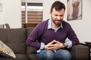 Gastritis symptoms including upper abdominal pain, bloating, and nausea