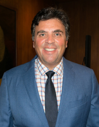 Richard A. Klass, Esq., Principal, wearing dark blue tie, checked shirt and blue suit coat.