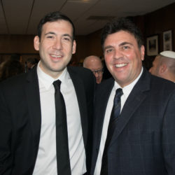 Two men in business attire, posing for photo. Todd Sandler, director of the Brooklyn Jewish National Fund, on left, and Richard Klass on the right. Photo by Rob Abruzzese.