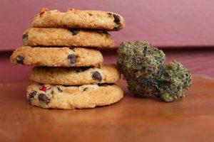 Marijuana cookies with a marijuana flower; image by Margo Amala, via Unsplash.com.