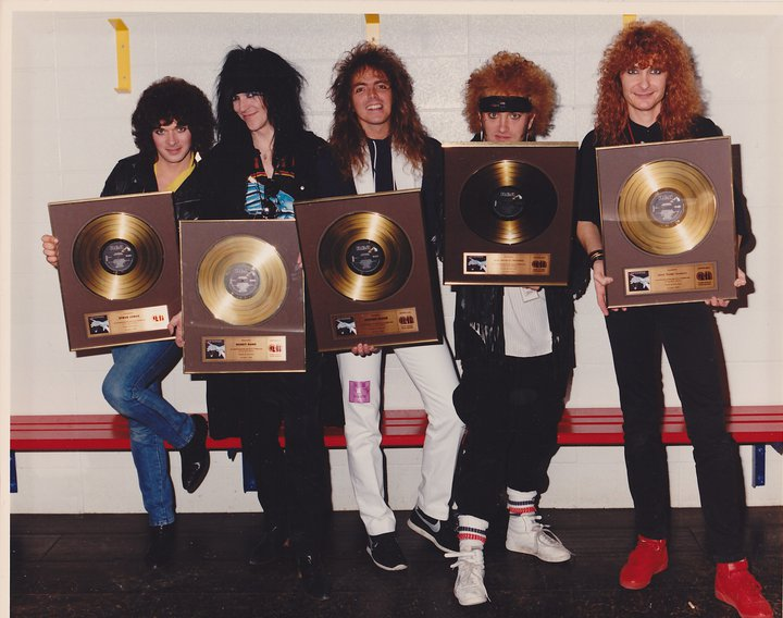 Autograph receiving their gold awards for SIGN IN PLEASE : Legendary Rock  Interviews