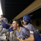 Christian Sanford and Gehrig Timmons of Henderson, Nev., Post 40 celebrate teammate Nick Thompson's double, which started a 5 run rally in the ninth-inning. They would defeat Bryant, Ark., Post 298 3-7 in game 13 of The American Legion World Series on Monday, August 14, 2017 in Shelby, N.C.. Photo by Matt Roth/The American Legion.