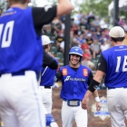 Lucas Ripa of Omaha, Neb., Post 1 high fives his teammates after scoring against Midland Mich., Post 165 during game 5 of The American Legion World Series on Friday, August 11, 2017 in Shelby, N.C.. Photo by Matt Roth/The American Legion.