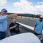 Tim Senkowski, center, listens to Jan Driessen, left, as he makes notes about a storm in the distance. Senkowski was given the opportunity to go on a flight in a glider as a part of an Operation Comfort Warriors grant during The American Legion's 99th annual National Convention in Truckee, Calif., on Saturday, August 19, 2017 Photo by Lucas Carter/The American Legion.