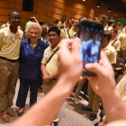 Jarred Walker, left, and Chann Austine Cortes, right take a photo with Holocaust survivor Nesse Godin after she spoke to the American Legion Boys Nation delegates on Thursday, July 27, 2017. Photo by Lucas Carter / The American Legion.
