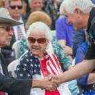 Medal of Honor recipient James C. McCloughan, right, shakes hands with Duane Dewey, also a Medal of Honor recipient with Post 49, before a memorial dedication ceremony at The American Legion Edward W. Thompson Post 49 in South Haven, Mich. Photo by Robert Franklin/The American Legion