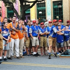 Members of the Randolph County, N.C., team celebrate after coming from behind to defeat Midland, Mich., during the cornhole tournament at the American Legion World Series Host City Welcome event Wednesday, August 9, 2017 in uptown Shelby, N.C.