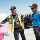 Brad Watkins of Post 177 in Fairfax, Va. greets Hong Ilgon and Kang Youngsoo from South Korea in Baker, Nev. on Tuesday, August 15, 2017. Photo by Clay Lomneth / The American Legion.