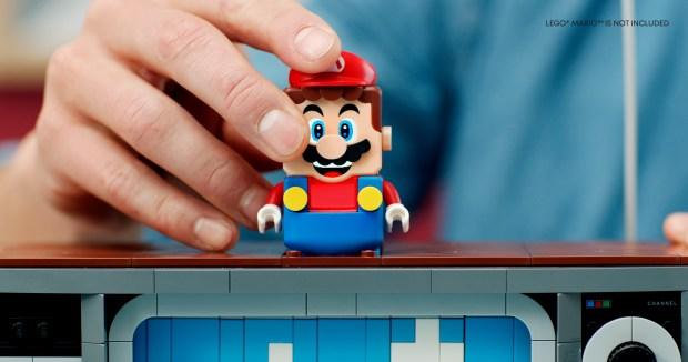 LEGO Super Mario sitting on top of the TV built of LEGO bricks