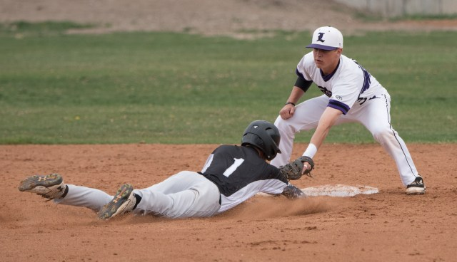 Lehi's Tyler Willis tags a runner at second base. Photo credit: Josh Hansen