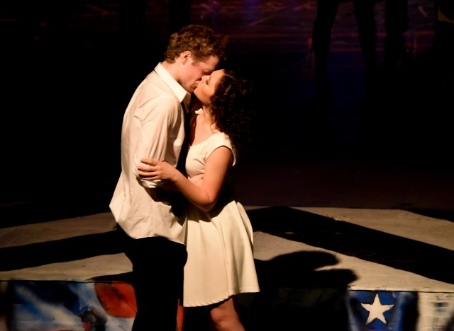 "Lead actors Andrew James Tesch ""Benny"" and Maddie Beck ""Nina"" share an on-stage kiss."
