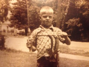 Bill Fowler, 8, holds his catch triumphantly.
