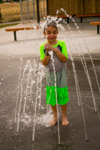 Ryan (7) loves getting sprayed by the water. Photo: Kaye Collins