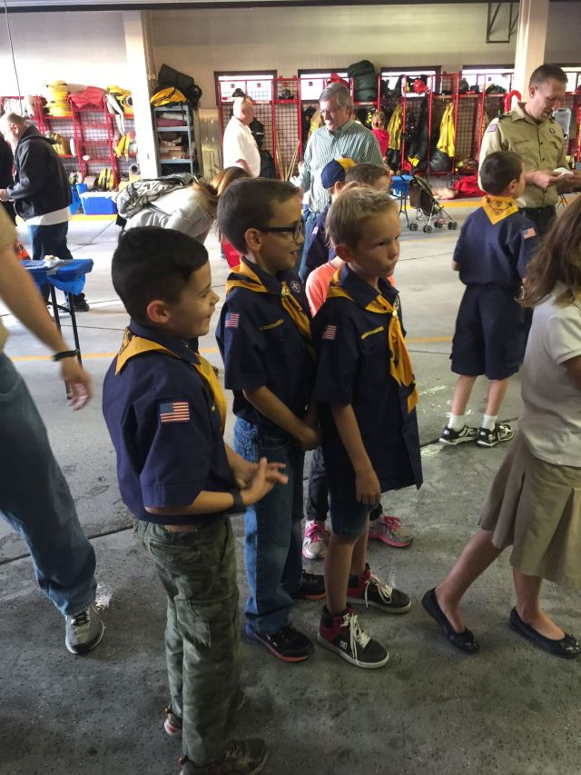 Cub Scouts from pack 1347 receive instruction about how to spray water at the bottom of flames to extinguish them. Photo: Kaye Collins