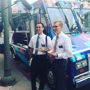 Missionaries from the LDS Church come help the Lei-Away Leidies sell their food. Photo courtesy of Carey Ofahengaue