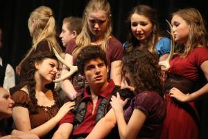 "Gaston surrounded by admirers in Skyridge's ""Beauty and the Beast."""