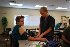 Students at MATC practice drawing blood.