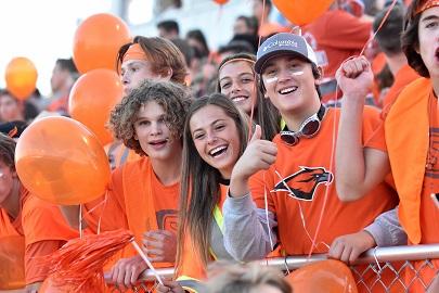 Skyridge student body cheering on the falcon football team. Taken by Matt Paepke