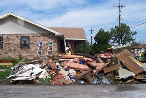 Photo of garbage outside a man's house post-Katrina