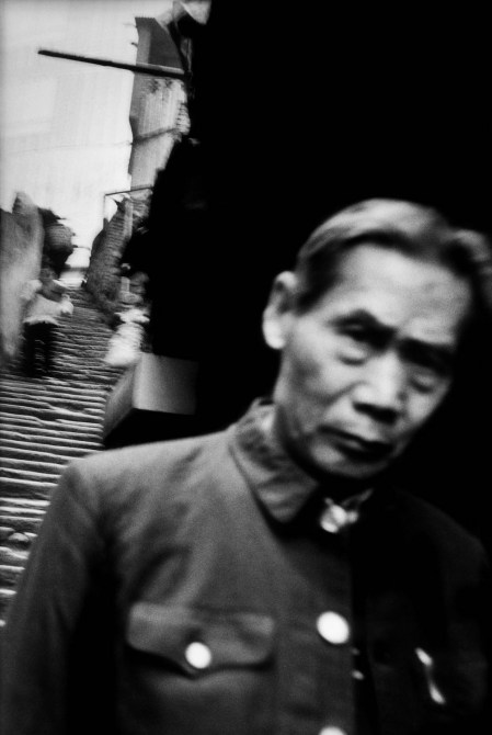 A man in a Mao suit in the heart of the city's working-class neighborhood. Chongqing.