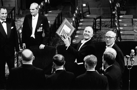 Nobel Prize Ceremony, Stockholm, November 1958. Dr. George Beadle from Caltech in Pasadena, California, winner of the Nobel Prize in 1958 for developing the one gene, one enzyme theory, raises his Nobel Prize for Baldwin's camera