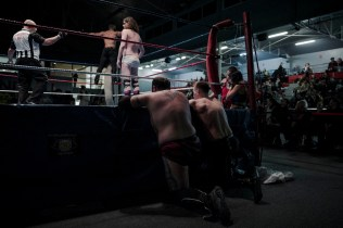 Wrestler Dark Mundo and Maeven, foreground, watch Zack and Lord Steven Crowley's fight during the wrestling charity gala in Ivry Sur Seine, south of Paris, Saturday, Feb. 24, 2018.