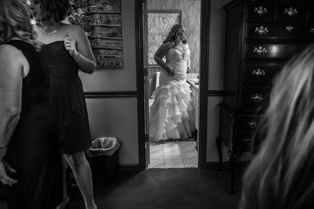 Bride looks in mirror one last time before exiting, Pilot Mountain, NC