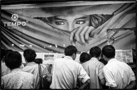 Shanghai, People's Republic of China, June 1989. News of the student protests being crushed in Tiananmen Square, Peking (Beijing) appears on huge dazibao posters on walls in Shanghai.