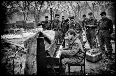Grozny, Chechnya, January 1995. A soldier playing piano at the headquarters of the Russian army.