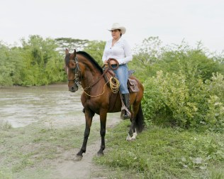 Leidy. She lives by the banks of the Magdalena River. With hes horse she travels long distances in search of signs of bodies