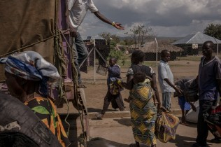 SEBAGORO, UGANDA - MARCH 22: Congolese refugees load their belongings onto a truck bound for Kyangwali refugee settlement camp after landing in Sebagoro, Uganda on March 22, 2018. Violence in Ituri Province in northeastern Democratic Republic of Congo has displaced more than 400,000 people including approximately 40,000 refugees who have fled to Uganda.