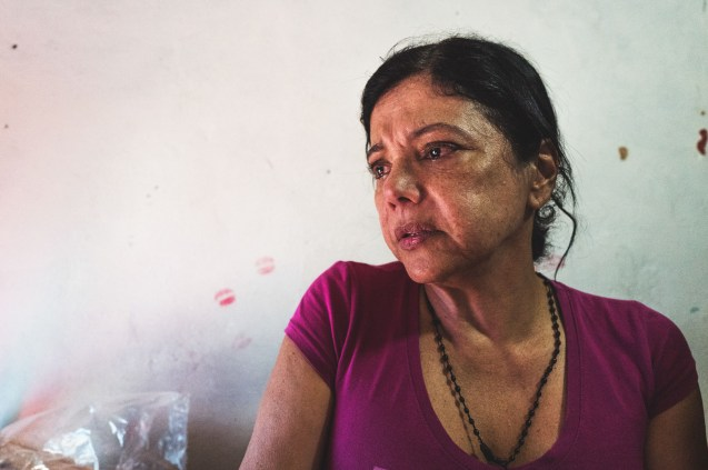 "LA YAGUARA DETENTION CENTRE, CARACAS, December 2018. 61 years old La Nena cries after receiving a visit from family and friends. She came into the cell saying that her heart is ""shrunken"". Her son had made an instragram account to protest against her detention. She also shared that she never imagined that the world of the prison would give her a family that takes care, comforts and helps her to move forward"