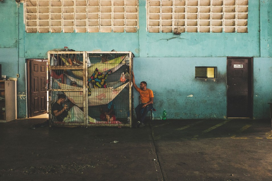 POLI-NAGUANAGUA, CARABOBO, March 2018. Seven male detainees wait inside a cage for their trial. According to a police officer, a couple of weeks ago a prisoner committed suicide inside this cell by hanging himself
