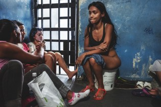 LA YAGUARA CENTER OF DETENTION, CARACAS, March 2018. Because of the overcrowding, the conditions these women live in are very unhygienic. Due to the lack of water or facilities to go to the toilet, they use a bucket as a toilet bowl. Once it is full, they throw the waste down the drain where they shower