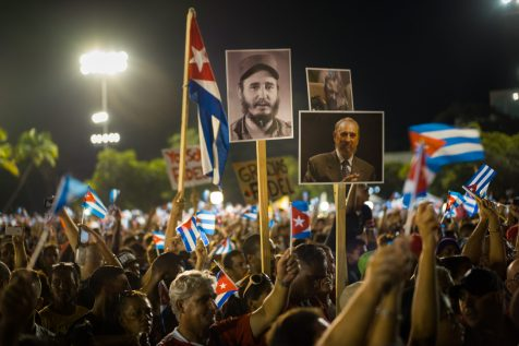 """Hundreds of thousands of people in the Plaza de la Revolucion in Santiago de Cuba, where the last stop of the funeral convoy took place, before the ashes of Fidel Castro were entombed in the cemetery of Santa Ifigenia. The crowd carry Cuban flags and images of the """"Lider Maximo"""", in front of a stage where the President. Raul Castro, pays his last respects to his brother. Santiago de Cuba, 3 December 2016."""