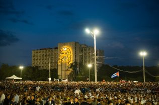 "Millions of people in Plaza de la Revolucion in Havana where the first public homage to the ""Comandante"" Fidel Castro took place. The ceremony was attended by many world leaders, who can be seen on stage in front of the building with the famous image of Che Guevara. Havana, 29 November 2016."