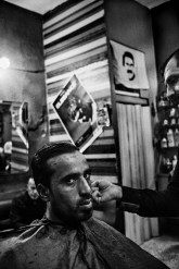 An image of Saddam Hussein, the former president of Iraq, is displayed in a barber shop