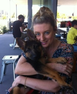 german-shepherd-puppy-getting-cuddles-from-mum