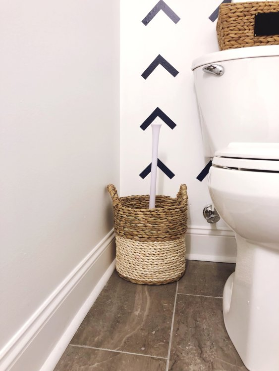 hide a plunger inside a tall basket in the bathroom